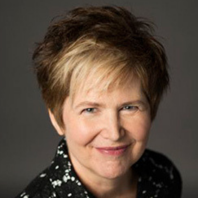 Headshot of Nancy Vonk looking straight into the camera with a power look